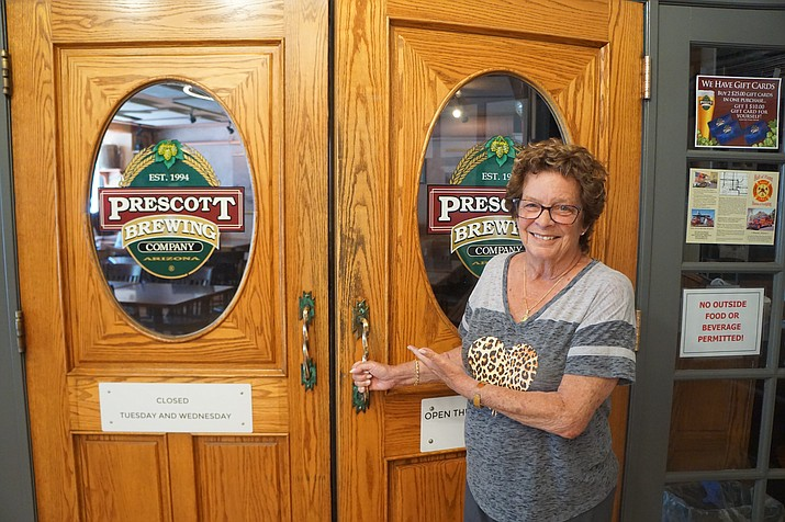 Roxane Nielsen of the Prescott Brewing Company stands at the entrance to the restaurant on Thursday, May 21, 2020, the first day the restaurant reopened after the COVID-19 pandemic shutdown. (Cindy Barks/Courier)