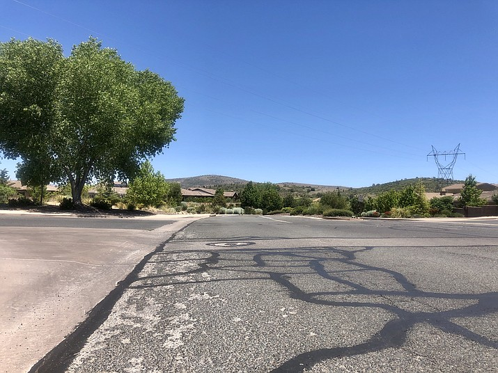 A network of cracks and indentions currently meets drivers along Smoke Tree Lane in the Prescott Lakes area. The Prescott City Council approved a $1.3 million project on Tuesday, May 26, 2020, that will involve milling away the existing asphalt and replacing it with four inches of new asphalt. (Cindy Barks/Courier)