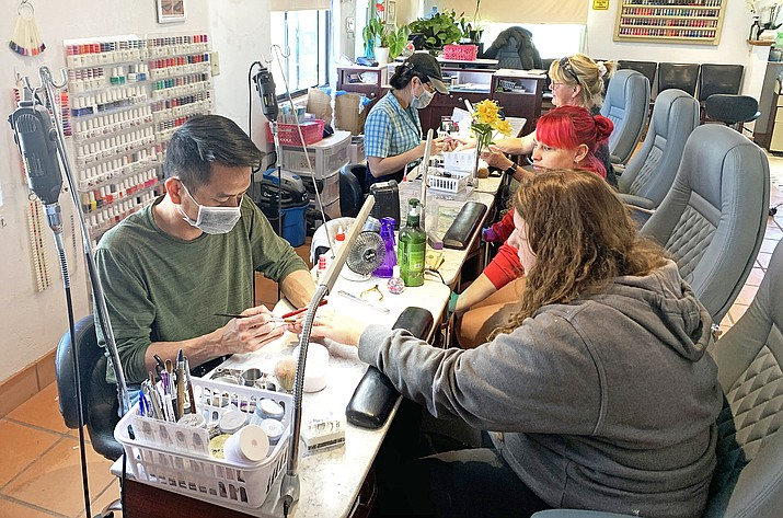 Route 66 Nail Salon in Williams offers manicures to customers May 20 after Gov. Doug Ducey lifted restrictions allowing salons, barbershops and gyms to re-open. (Loretta McKenney/WGCN)