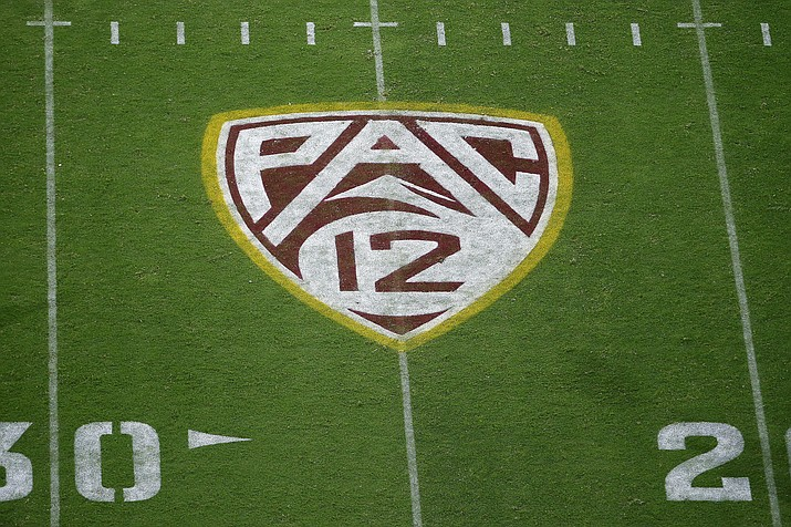 This Aug. 29, 2019, file photo shows the PAC-12 logo at Sun Devil Stadium during the second half of an NCAA college football game between Arizona State and Kent State in Tempe, Ariz. The Pac-12 Conference will allow voluntary workouts on campus for all sports beginning June 15, subject to the decision of each individual school and where allowed by local and state guidelines, the conference announced Tuesday, May 26, 2020. (Ralph Freso/AP, file)