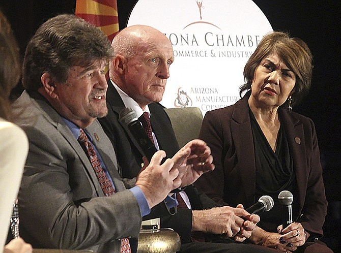 Democratic Senate Minority Leader David Bradley, left, speaks as House Speaker Rusty Bowers, and House Minority Leader Charlene Fernandez listen as Arizona's four top legislative leaders appeared at the Arizona Chamber of Commerce and Industry's annual legislative forecast luncheon Friday, Jan. 10, 2020 in Phoenix. Ducey told a crowd of about 1,500 business leaders that the state's economy continues to hum and he'll continue his vision of investing in government while lowering taxes. (Bob Christie/AP)