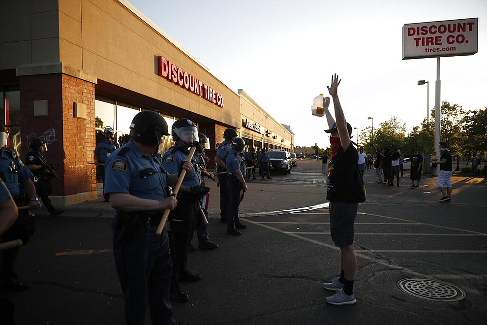 Demonstrators gather Thursday, May 28, 2020, in St. Paul, Minn. Protests over the death of George Floyd, the black man who died in police custody, broke out in Minneapolis for a third straight night. (AP Photo/John Minchillo)