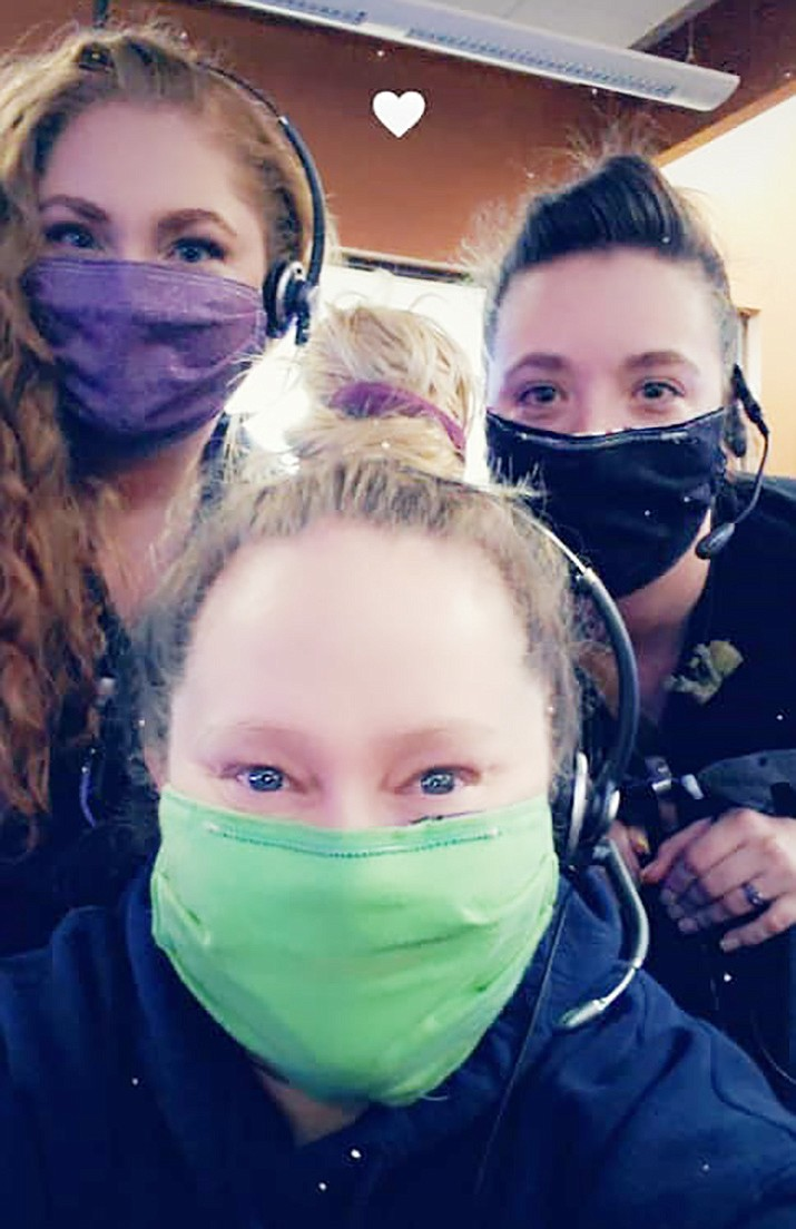 From the left, Elaina Avila, Jennifer Noss and Amber Presmyk are masked up and ready for duty at the Cottonwood Public Safety Communications Center. Adjustments for the staff have included additional health questions in screening callers and finding ways to get errands such as shopping done while working 12-hour shifts as stores reduce their hours. Courtesy photo