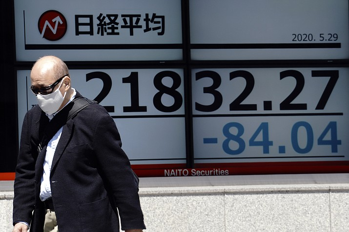 A man walks past an electronic stock board showing Japan's Nikkei 225 index at a securities firm in Tokyo Friday, May 29, 2020. Shares fell Friday in Asia after Wall Street's rally petered out amid worries about flaring U.S.-China tensions. (Eugene Hoshiko/AP)
