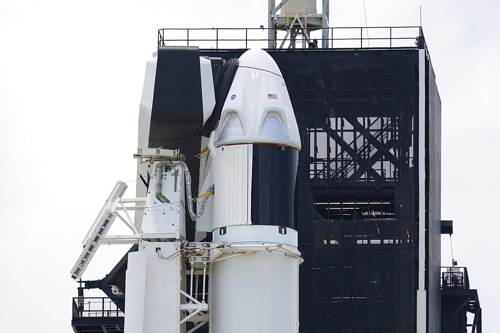 The SpaceX Falcon 9, with Dragon crew capsule on top of the rocket, sits on Launch Pad 39-A, Friday, May 29, 2020, at the Kennedy Space Center in Cape Canaveral, Fla. Two astronauts will fly on the SpaceX Demo-2 mission to the International Space Station scheduled for launch on Saturday, May 30. For the first time in nearly a decade, astronauts will blast into orbit aboard an American rocket from American soil, a first for a private company. (AP Photo/David J. Phillip)