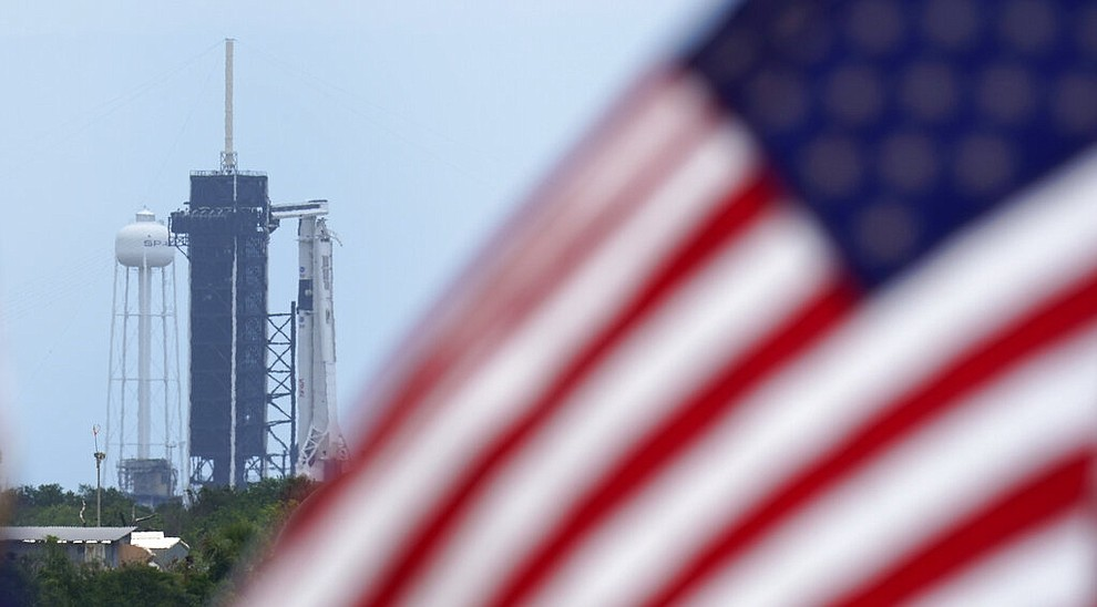 A SpaceX Falcon 9, with NASA astronauts Doug Hurley and Bob Behnken in the Crew Dragon capsule, sits on Launch Pad 39-A at the Kennedy Space Center in Cape Canaveral, Fla., Saturday, May 30, 2020. The two astronauts are on the SpaceX test flight to the International Space Station scheduled to liftoff Saturday. (AP Photo/David J. Phillip)