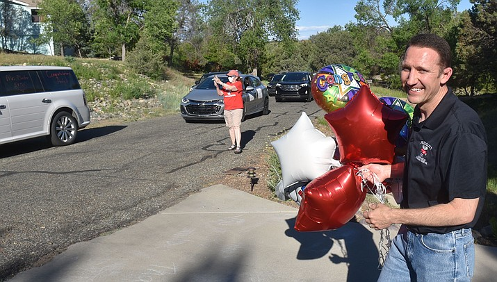 Mile High Middle School Principal Andy Binder is treated to a surprise parade at his home. (Jesse Bertel/Courier)