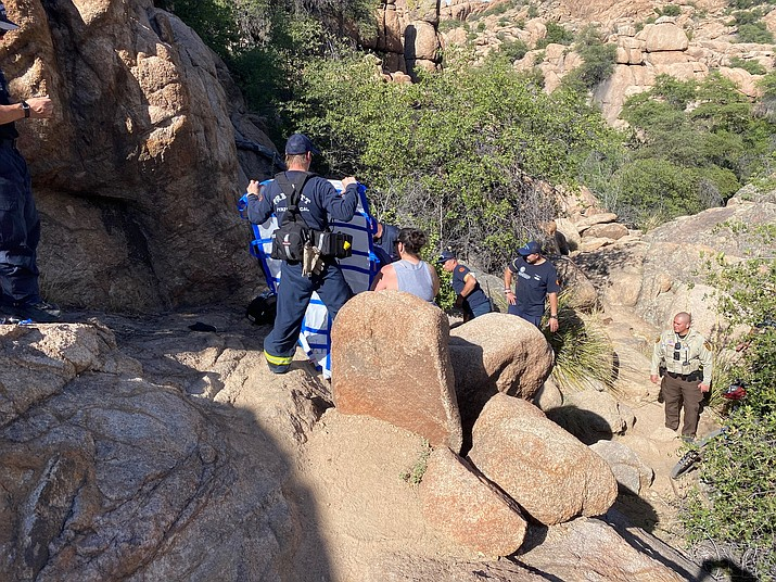 Members of the Prescott Fire Department assist in a rescue at Watson Lake after a group of hikers failed to bring enough water on their trip Saturday, May 30, 2020, in Prescott.  (Prescott FD/Courtesy)