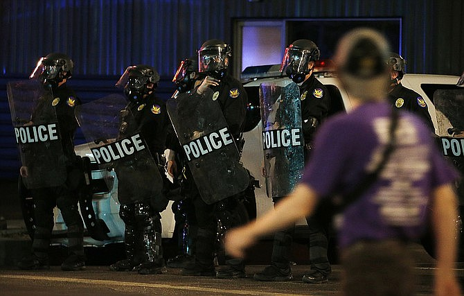 Phoenix Police keep protesters away from Phoenix Police Headquarters May 30, in Phoenix, protesting the death of George Floyd, a handcuffed black man who died in police custody with much of the arrest captured on video of a Minneapolis police officer kneeling on the neck of Floyd. (Ross D. Franklin/AP)