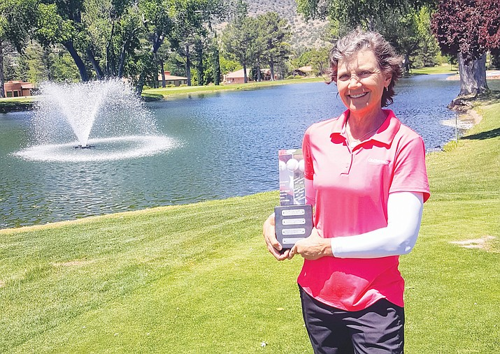 Betty Uhrig earning the President's Cup at Oakcreek Country Club Women's Golf.