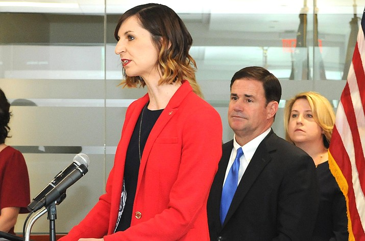 State schools chief Kathy Hoffman in March year with Gov. Doug Ducey announcing schools would be closed for the balance of the year. Hoffman is now providing a ``roadmap'' of issues for schools to consider when deciding how -- and if -- to reopen. (Capitol Media Services file photo by Howard Fischer)