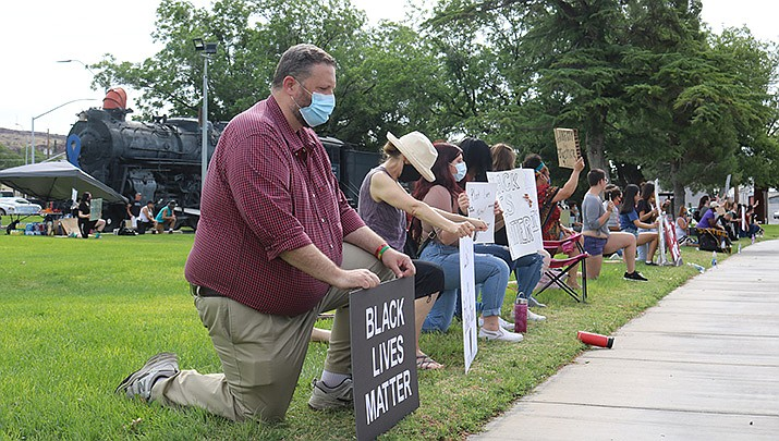 Several dozen protesters had turned out by 8 a.m. Tuesday, June 2 at Locomotive Park, 310 W. Beale St. (Photo by Travis Rains/Kingman Miner)