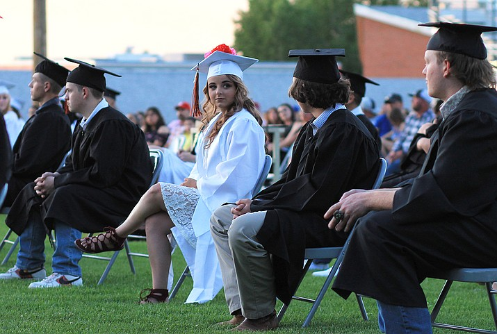 Riley Hollis looks at CJ Henson during the Williams High School 2020 graduation ceremony May 29. (Wendy Howell/WGCN)