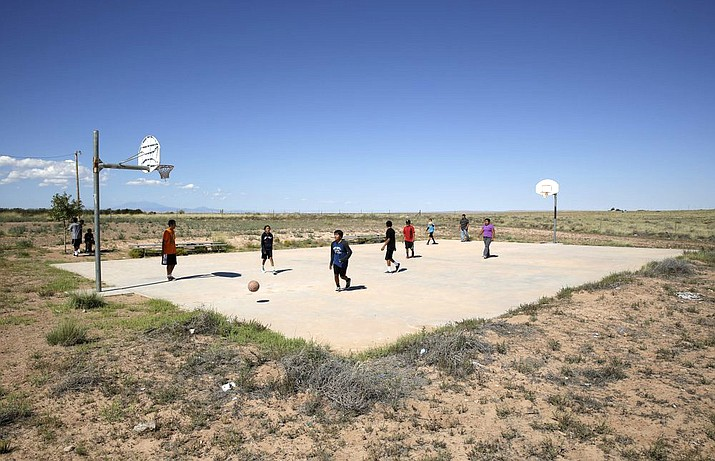 Students play basketball at Little Singer Community School in Birdsprings, Arizona, on the Navajo Nation in 2014 . (AP Photo/John Locher, File)