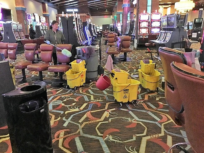 Navajo Gaming Team members completing additional cleaning and removal of chairs at Northern Edge Navajo Casino. (Photo courtesy of Neil Johns, NNGE)