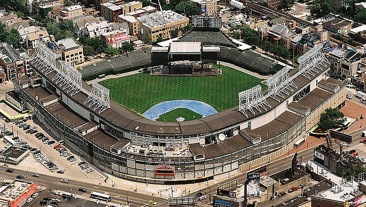 Major League Baseball has rejected a proposal by the players for a 114-game regular season schedule that would end Oct. 31. Instead the MLB is proposing a schedule of about 50 regular season games with the World Series concluding in October before a projected second wave of coronavirus. Wrigley Field in Chicago is shown. (Photo by Towpilot, cc-by-sa-3.0, https://bit.ly/2BvI2lw)