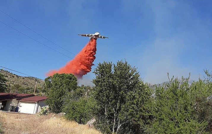 An airtanker passes over the Park Fire in Bagdad as firefighters work to put out the blaze Thursday, May 21, 2020. (YCSO/Courtesy)