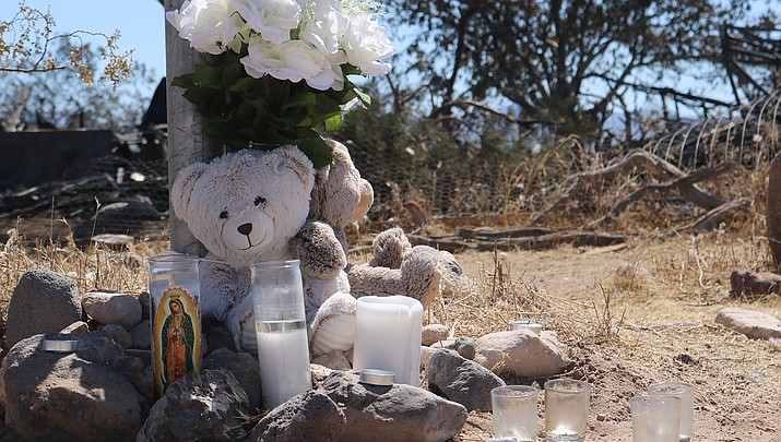 This memorial is located outside a burned home in the 4800 block of N. Elgin Road in Golden Valley where two girls ages 4 and 11 died, and four other occupants were injured, in a structure fire on Wednesday, June 3. The parents, a male roommate and another child were transported to a Las Vegas hospital where they are listed in critical condition. Another child was hospitalized for observation, while another escaped without injuries. The cause of the early morning blaze is under investigation, according to the Mohave County Sheriff's Office. (Photo by Travis Rains/Kingman Miner)