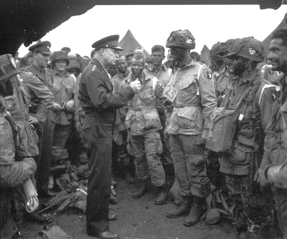 """Supreme Commander Dwight Eisenhower gives the order of the day """"Full victory - Nothing else"""" to paratroopers of the 101st Airborne Division at the Royal Air Force base in Greenham Common, England, three hours before the men board their planes to participate in the first assault wave of the invasion of the continent of Europe, June 5, 1944. (AP Photo)"""