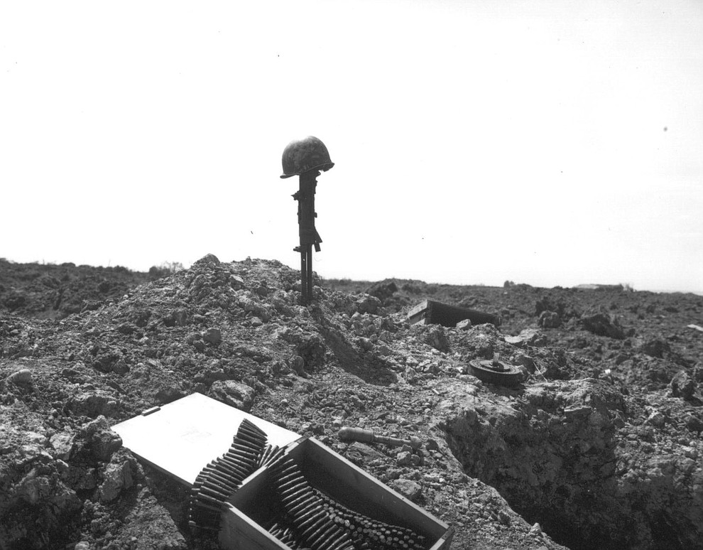 A tribute to an unknown American soldier, who lost his life fighting in the landing operations of the Allied Forces, marks the sand of Normandy's shore, in June 1944. (AP Photo)..