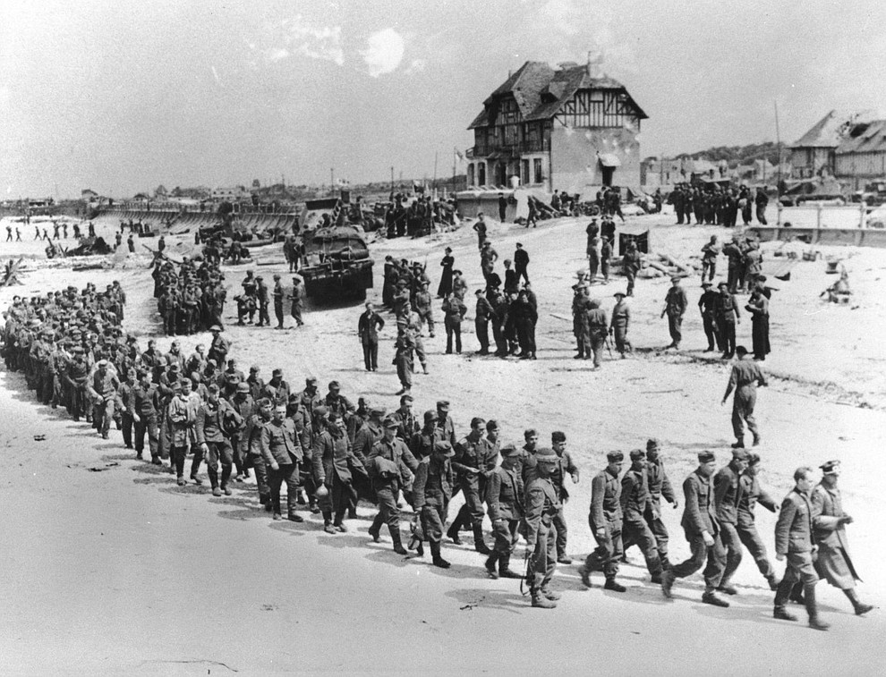 German prisoners of war, captured during the Allied Normandy invasion, are marched to the ships that bring them into captivity in England, in June 1944, at Bernieres-sur-mer, France. (AP Photo)..