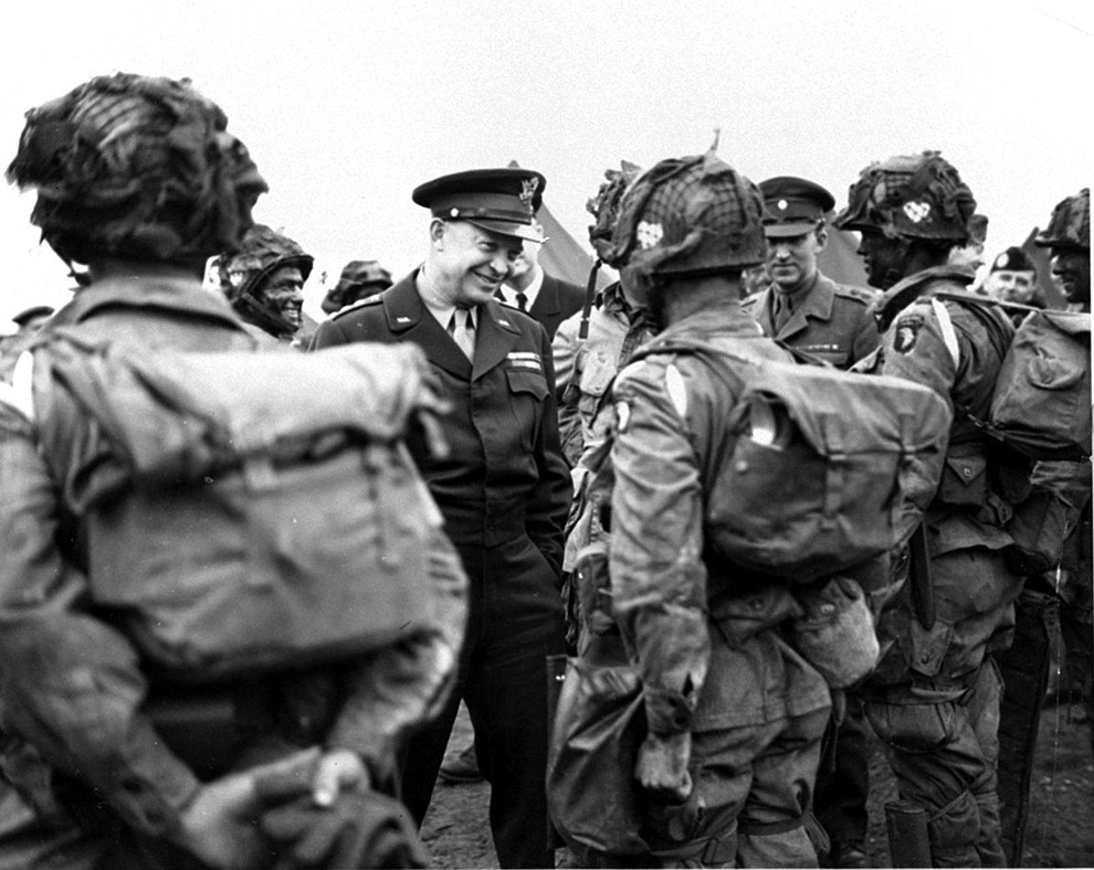 """In this image provided by the U.S. Army Signal Corps, General Dwight Eisenhower gives the order of the day, """"Full Victory - Nothing Else,"""" to paratroopers somewhere in England just before they board their planes to participate in the first assault in the invasion of the continent of Europe, June 6, 1944. (AP Photo/U.S. Army Signal Corps Photo)"""