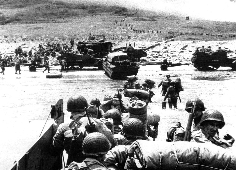 Ducks (amphibious trucks) and a half-track follow foot troops ashore during the World War II opening invasion of France on a 100-mile front along the Normandy coast by Allied forces on June 6, 1944. (AP Photo/U.S. Coast Guard)..