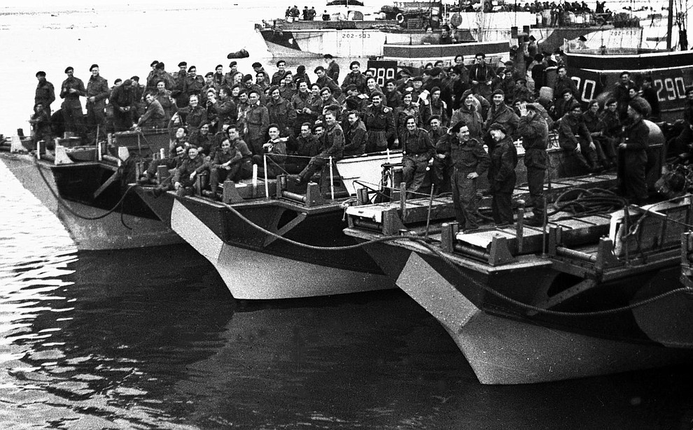British Commandoes assemble at a coastal port in England, June 4, 1944, in readiness for sailing to France for the liberation of Europe. (AP Photo/British Official Photo)..