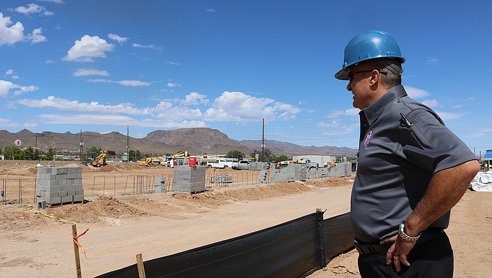 Building Official Chris Young of the Kingman Fire Department stands at the location of the new Department of Economic Security Building under construction at 2400 Airway Ave. (Miner file photo)