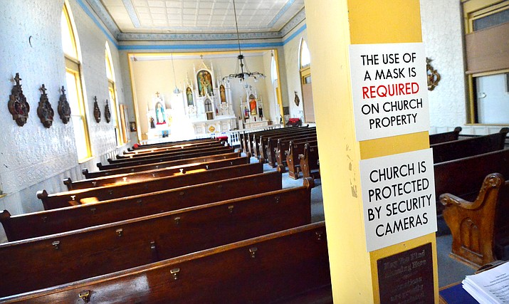 Holy Family Church in Jerome explains its policy for masks as people enter the church building. VVN/Vyto Starinskas