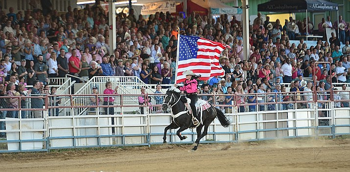 The American flag is presented during the second performance of the Prescott Frontier Days Rodeo on July 2, 2019. (Les Stukenberg/Courier, file)
