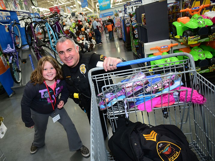 Prescott Valley Police Sgt. Jason Kaufman volunteers at Shop With A Cop, an annual community event for youth. (Courier file)