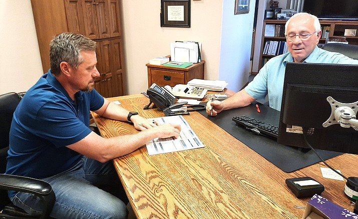 Mike Mahon, left, talks with his father, John, this week. Mike Mahon took over June 8 as owner of Mahon Accounting and Tax Service in Cottonwood. VVN/Jason W. Brooks