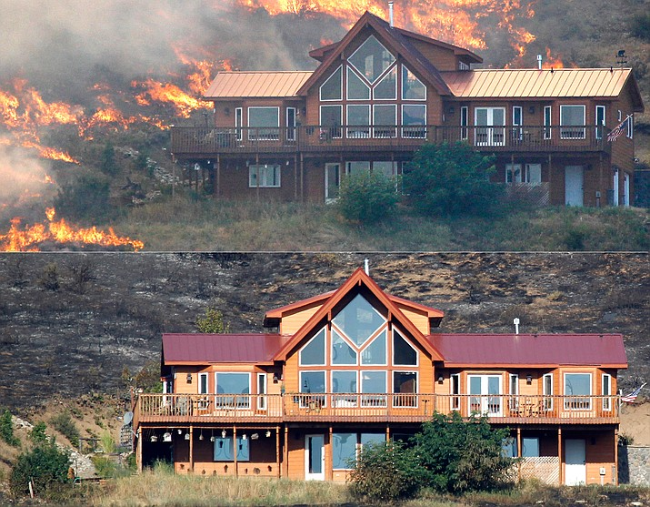 A house (top) on a hillside above Bettas Road near Cle Elum, Washington, is surrounded by flames Aug. 14, 2012. A spokesman for the Washington state Department of Natural Resources said the house survived the fire (below) because of the defensible space around the structure with the placement of the driveway and the lack of trees and brush up against the house preventing flames from reaching it. (AP Photo/Elaine Thompson)