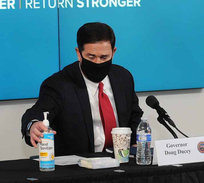 Gov. Doug Ducey arrives at Wednesday's press conference wearing a mask. (Capitol Media Services photo by Howard Fischer)
