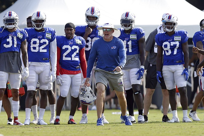 In this Aug 13, 2019, file photo, Buffalo Bills coach Sean McDermott yells during the team's NFL football training camp with the Carolina Panthers in Spartanburg, S.C. NFL general managers and coaches, and those who assist them, work within a highly competitive culture. Putting in extremely long hours is simply understood as part of the job. Unless, there's a pandemic. (AP Photo/Gerry Broome, File)