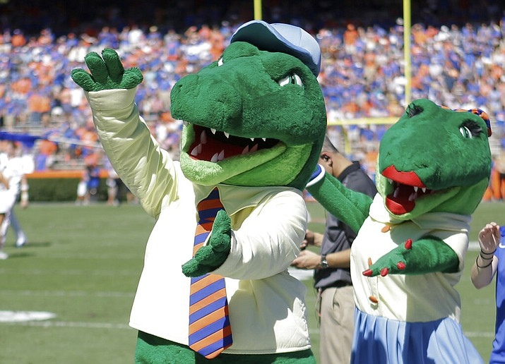 In this Nov. 7, 2015, file photo, Albert and Alberta, the mascots for Florida, do the gator chomp before the first half of an NCAA college football game against Vanderbilt in Gainesville, Fla. The University of Florida is ending its 'gator bait' cheer at football games and other sports events because of its racial connotations, the school's president announced Thursday, June 18, 2020, in a letter making several other similar changes on campus. (AP Photo/John Raoux, File)