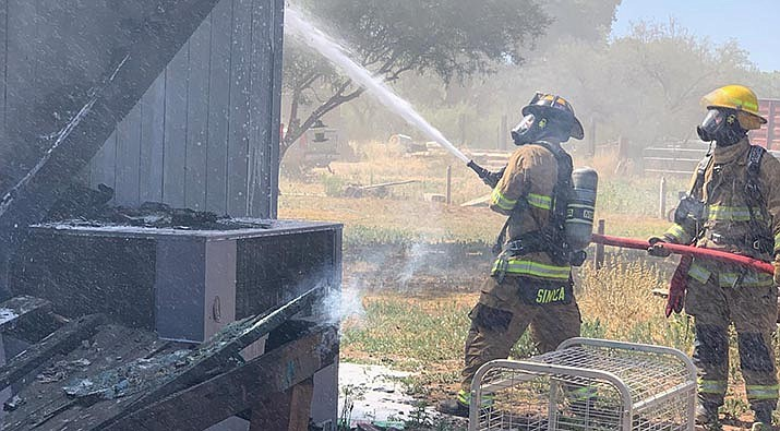 Copper Canyon Fire and Medical District firefighters douse a fire on Cloverleaf Ranch Road in Camp  Verde on Wednesday. Courtesy of Copper Canyon Fire and Medical
