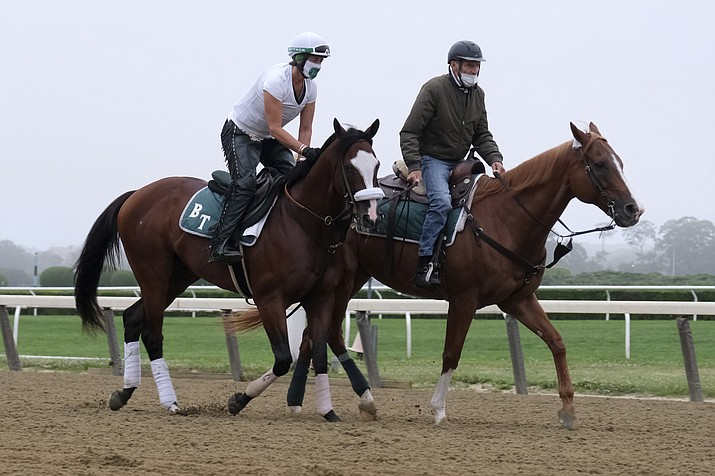 Belmont Stakes hopeful Robin Smullen on Tiz the Law, left, is led around the track by trainer Barclay Tagg during a workout at Belmont Park in Elmont, N.Y., Friday, June 19, 2020. (Seth Wenig/AP)