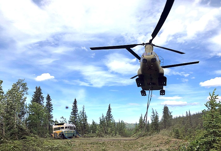 """In this photo released by the Alaska National Guard, Alaska Army National Guard soldiers use a CH-47 Chinook helicopter to removed an abandoned bus, popularized by the book and movie """"Into the Wild,"""" out of its location in the Alaska backcountry Thursday, June 18, 2020, as part of a training mission. Alaska Natural Resources Commissioner Corri Feige, in a release, said the bus will be kept in a secure location while her department weighs various options for what to do with it. (Sgt. Seth LaCount/Alaska National Guard via AP)"""