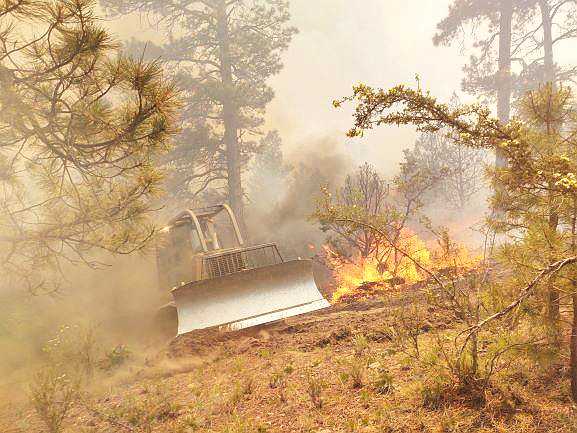 A dozer operator works the Mangum Fire on the North Kaibab Plateau June 18. (Photo/Inciweb)