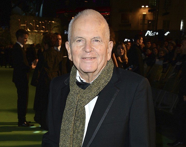 """In this Dec. 12, 2012 photo, actor Ian Holm appears at the premiere of """"The Hobbit: An Unexpected Journey"""" in London. Holm, the acclaimed British actor whose long career included roles in """"Chariots of Fire"""" and """"The Lord of the Rings"""" has died, his agent said Friday. He was 88. Holm died peacefully in the hospital, surrounded by his family and carer, his agent, Alex Irwin, said in a statement. His illness was Parkinson's related. (Jon Furniss/Invision/AP, File)"""