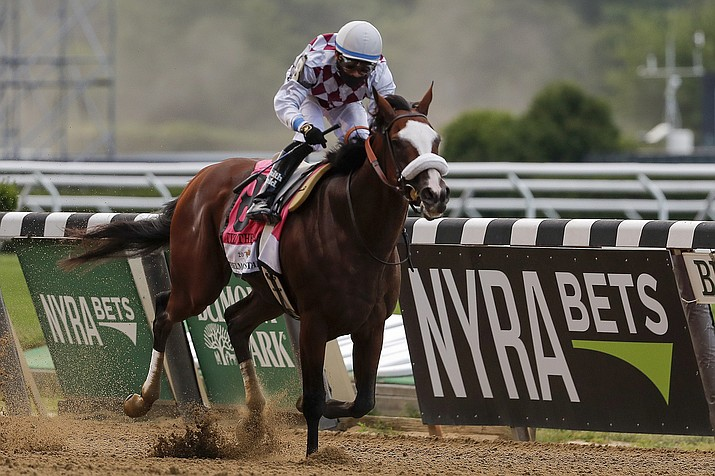 Tiz the Law (8), with jockey Manny Franco up, crosses the finish line to win the 152nd running of the Belmont Stakes horse race Saturday, June 20, 2020, in Elmont, N.Y. (Seth Wenig/AP)