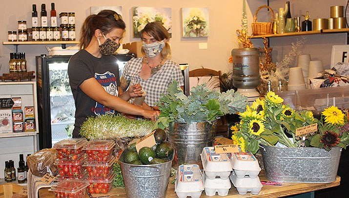 An array of local vegetables, flowers, eggs and other products are available at West of Third, a sustainable lifestyle boutique at 224 E. Beale St. (Photo by Agata Popeda/Kingman Miner)