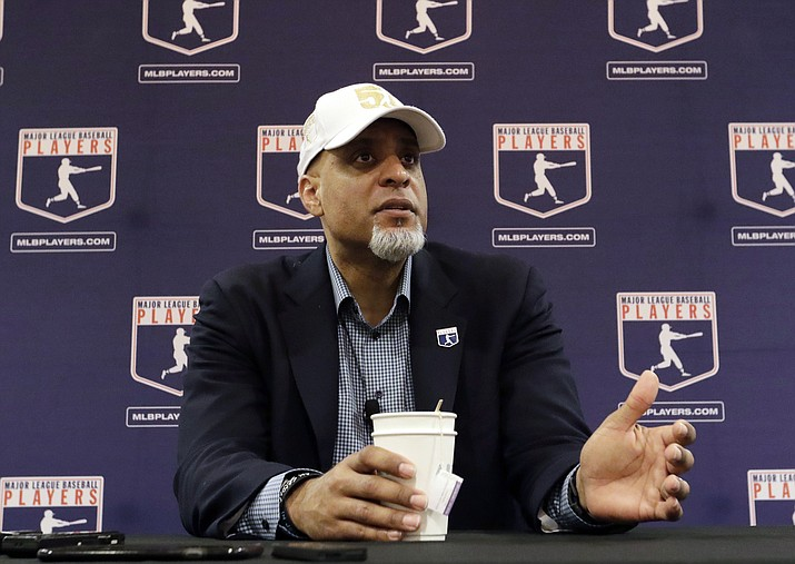 In this Feb. 19, 2017, file photo, Major League Players Association Executive Director Tony Clark, answers questions at a news conference in Phoenix. Major League Baseball plans to unilaterally issue a 60-game schedule for its shortest season since 1878 after the players' association rejected a negotiated deal of the same length, putting the sport on track for a combative and possibly unhappy return to the field amid the coronavirus pandemic. (Morry Gash/AP File)