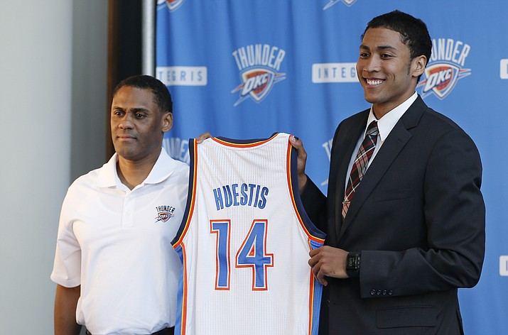 In this June 27, 2014, file photo, Oklahoma City Thunder vice president and assistant general manager Troy Weaver, left, holds a jersey with forward Josh Huestis as Huestis is introduced during a news conference in Oklahoma City. The Detroit Pistons hired former Oklahoma City Thunder executive Troy Weaver as their new general manager Thursday, June 18, 2020. (Sue Ogrocki/AP File)