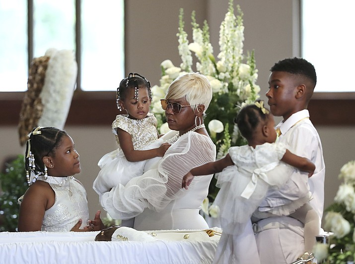 Tomika Miller, wife of Rayshard Brooks, holds their 2-year-old daughter Memory while pausing with her children during the family processional at his funeral in Ebenezer Baptist Church on Tuesday, June 23, 2020 in Atlanta. Brooks, 27, died June 12 after being shot by an officer in a Wendy's parking lot. Brooks' death sparked protests in Atlanta and around the country. (Curtis Compton/Atlanta Journal-Constitution via AP, Pool)