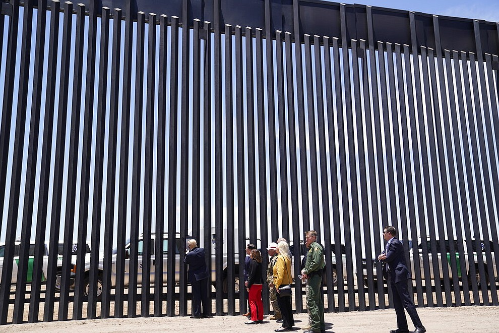 President Donald Trump signs a plaque as he tours a section of the border wall, Tuesday, June 23, 2020, in San Luis, Ariz. (AP Photo/Evan Vucci)