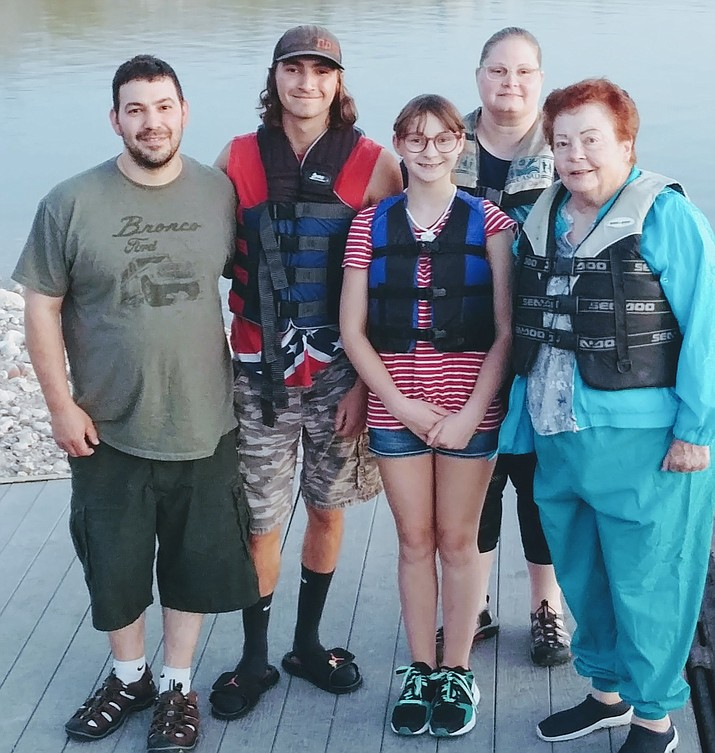 The Mussmann family of Iowa and Page McDonald of Kingman, right, are shown before a fishing trip on Lake Mead. (Photo by Don Martin/For the Miner)