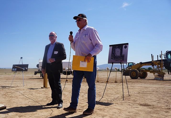 CP Technologies President/CEO Michael McCormack, left, and Jim Chamberlain of Chamberlain Development, right, talk to a crowd of several dozen people who turned out for a Wednesday, June 24, 2020, groundbreaking of the new CP Technologies building near the corner of Highway 89 and Deep Well Ranch Road in Prescott. (Cindy Barks/Courier)